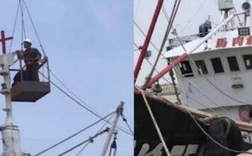 Empreiteiros do PCC do Condado de Qushan removendo uma cruz de um barco de pesca. (Foto: ChinaAid)